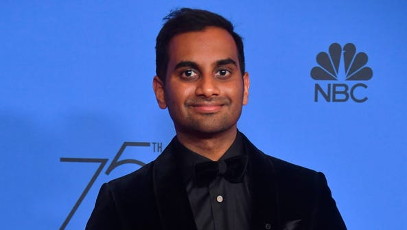 Aziz Ansari poses with the trophy for Best Performance