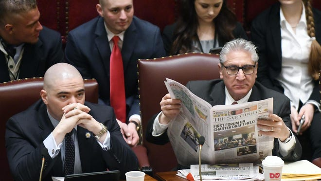 New York state Sens. Fred Akshar, R-Colesville, left, and James Tedisco, R-Glenville, wait for a session to start Friday in the Senate Chamber as legislative members work on the state budget at the state Capitol in Albany.