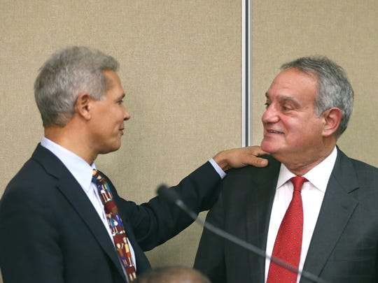 Daniel Lowengard  (right) will be the interim Rochester City School District Superintendent, is congratulated by his predecessor  Dr. Bolgen Vargas (left).
