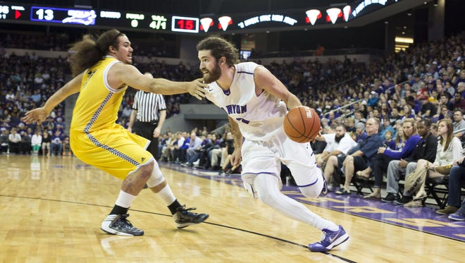 Grand Canyon's Daniel Alexander, right, drives past NAU's Ako Kaluna during their game in the CollegeInsider.com Tournamant last season at Grand Canyon University Arena in Phoenix.