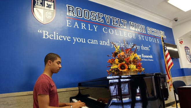 Senior Justice Medina plays the piano at Roosevelt High School in Yonkers, Feb. 26, 2016. Medina said he plays during his free periods so people can be relaxed.