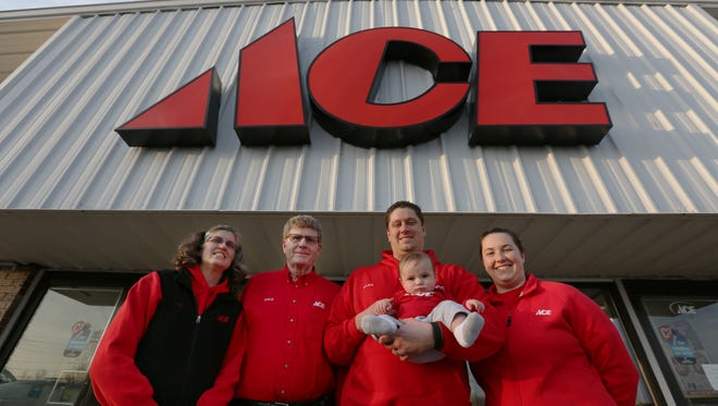 Lindner Ace Hardware owners Kim and Dale Lindner, left, pose for a portrait with their son, Ryan, and daughter-in-law, Stefanie, and 4-month-old grandson, Cory, in front of the Manitowoc store on Wednesday, March 9. The Lindners recently acquired a new store in Little Chute, which will join existing stores they own in Manitowoc and Green Bay.