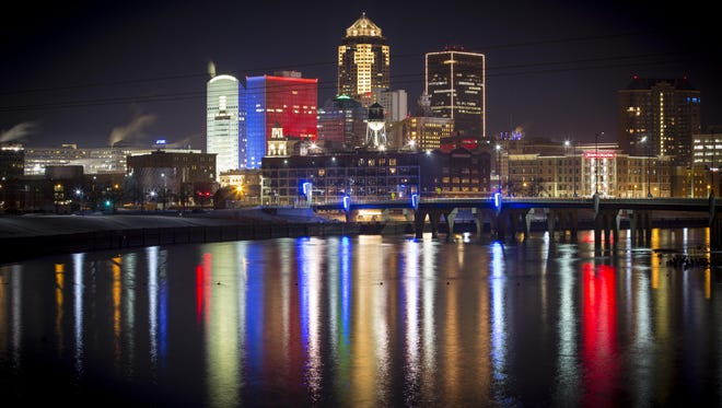 The Des Moines skyline is lit up red white and blue Monday Feb. 1, 2016, by the colored lights on the Financial Center Building on Iowa's caucus day.