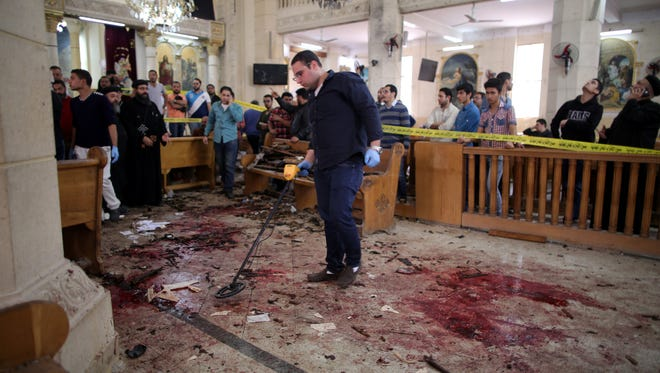 Security personnel investigate the scene of a bomb explosion inside Mar Girgis church in Tanta, Egypt, on April 9. 2017.