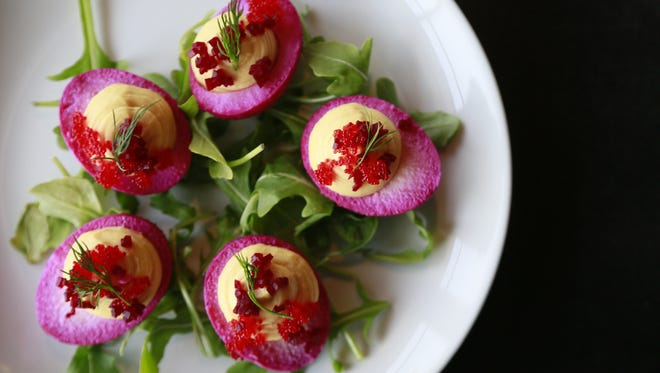 Deviled eggs from Axle Brewing Co.'s Livernois Tap beer hall and restaurant are pickled with beet juice, which turns the whites a vivid purple.