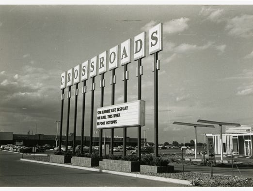 A large sign marks the main entry of Crossroads Shopping Center off of U.S. Highway 52, now know as Division Street, in 1966.