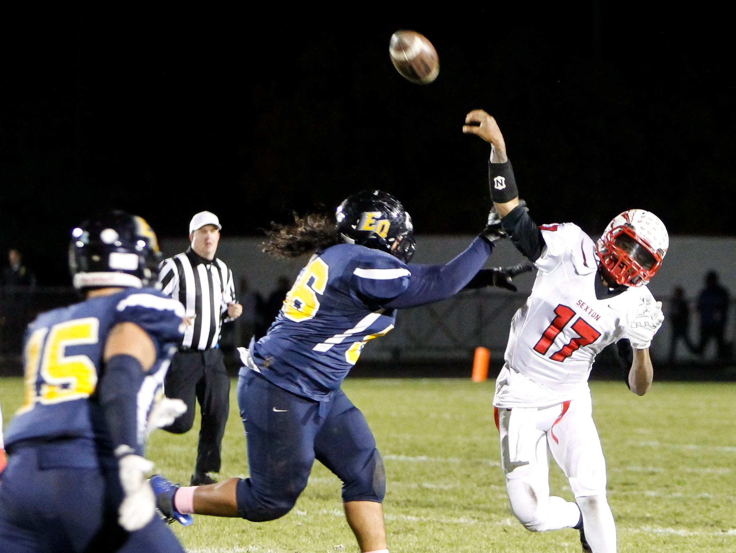 Sexton QB Marcus Alston throws against Lansing Eastern Friday, October 21, 2016 at Sexton. The pass was intercepted.