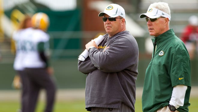 Green Bay Packers coach Mike McCarthy and general manager Ted Thompson watch the team's minicamp in this 2012 file photo.