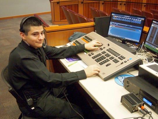 Silver Lake College student Leo Soto runs the sound