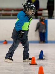 Jackson Smith, 5, of Marysville, works on his skating technique during a beginner skating class Tuesday.