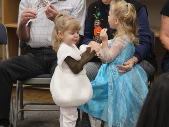 Toddlers and young children participated in a costume contest at the Carlsbad Public Library on Wednesday. More than one Elsa and Olaf were seen walking around.