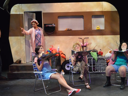 """Norbert (Ben Bailey) gets in trouble with Jeannie (Elizabeth Watson) as Pickles (Cassidy Beal), Lin (Brittany Lester) amd Betty (Kayla Fainer) catch some rays in the University of West Florida production of """"The Great American Trailer Park Musical."""""""