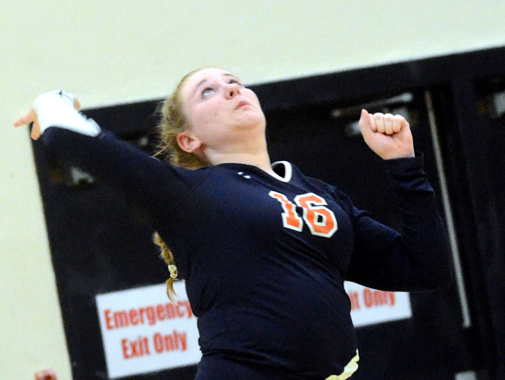 Beech High junior Britta Olund swings into a jump-serve during the second game.