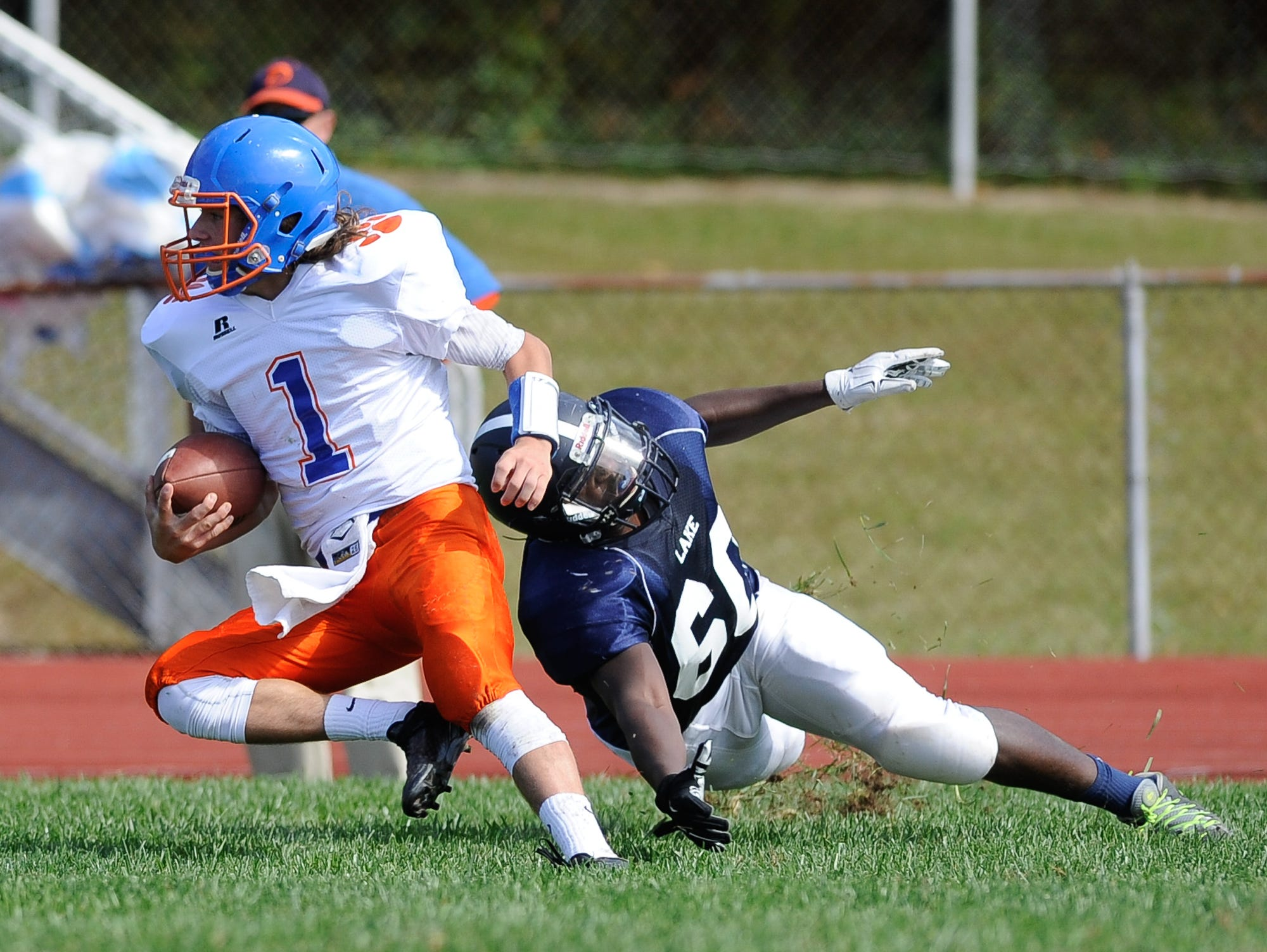 Lake Forest's #60 Dawaunta Parker misses a tackle on Delmar's quarterback #1 James Adkins in their 19-14 win over Delmar on Saturday at Lake Forest High School.