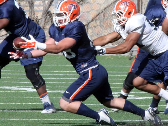 UTEP'S Augie Touris, 88, catches a short pass during