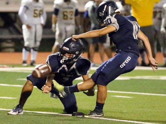 Love' Tovar kicks in a field goal during Del Valle's scrimmage game against Eastwood Friday night.