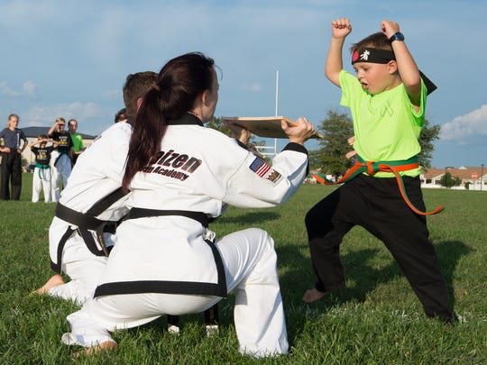 Second-grader Von Kleiv, 7, breaks his first boards during a karate demonstration at Laps For Lymphoma fundraiser at Major George S. Welch Elementary School on Dover Air Force Base. Von was diagnosed with lymphoma in 2016.