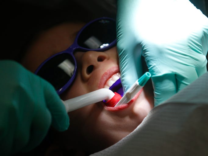 Patient Giana Murphy gets her teeth cleaned on Friday