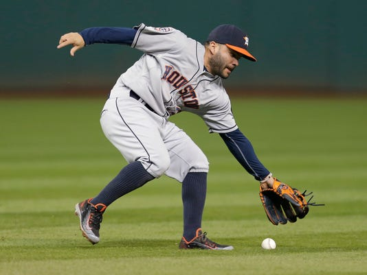 Houston Astros' Jose Altuve fields a single by Cleveland Indians' Yan Gomes during the eighth inning of a baseball game, Thursday, July 9, 2015, in Cleveland. The Indians won 3-1. (AP Photo/Tony Dejak)