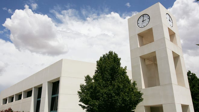 San Juan College is being sued by a former librarian who claims he was wrongfully terminated.