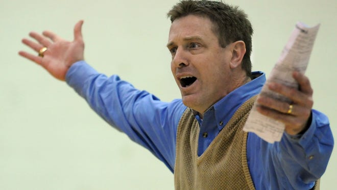 File photo shows Faulkner basketball Coach Jim Sanderson reacting to action on the court during a game. In his 24 years at the helm of the Eagles, Sanderson posted a record of 481-297.
