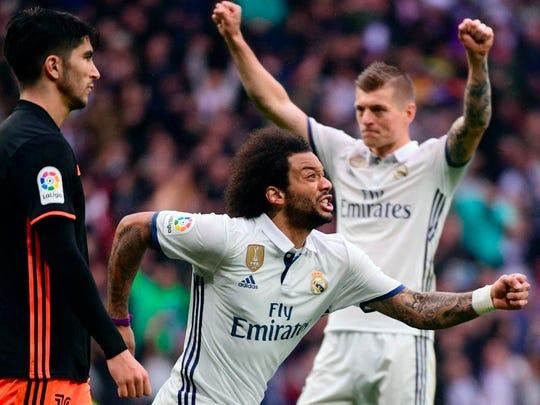 Real Madrid's Marcelo celebrates a goal against Valencia