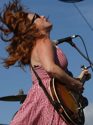 Cary Ann Hearst of Shovels and Rope plays guitar during