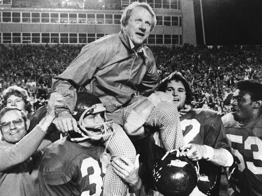 In this Dec. 6, 1975, file photo, Arkansas coach Frank Broyles is carried from the field following his team's 30-6 victory against Texas A & M.