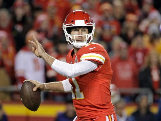FILE - In this  Saturday, Dec. 16, 2017 file photo, Kansas City Chiefs quarterback Alex Smith (11) looks for a receiver during the first half of an NFL football game against the Los Angeles Chargers in Kansas City, Mo. Two people with direct knowledge of the trade say the Kansas City Chiefs have agreed to deal quarterback Alex Smith to the Washington Redskins. The people spoke to The Associated Press on condition of anonymity because it can't be completed until the start of the new league year in March. (AP Photo/Charlie Riedel)