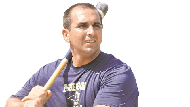 Eric Filipek has been the baseball coach at Roberson for four years.