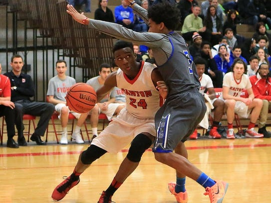 Muscling toward the basket against a Walled Lake Western