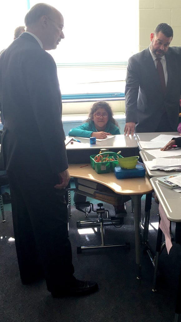 Gov. Tom Wolf and education Secretary Pedro Rivera visited a classroom at Goode K-8 School where some students have pedals under their desks.