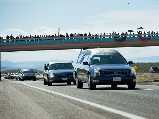 A hearse carrying the body of Hatch Police Officer