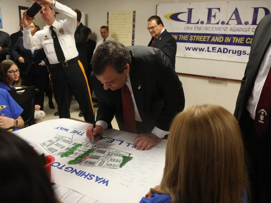 Here, Governor Christie signs a poster that celebrates the LEAD program at Washington School.