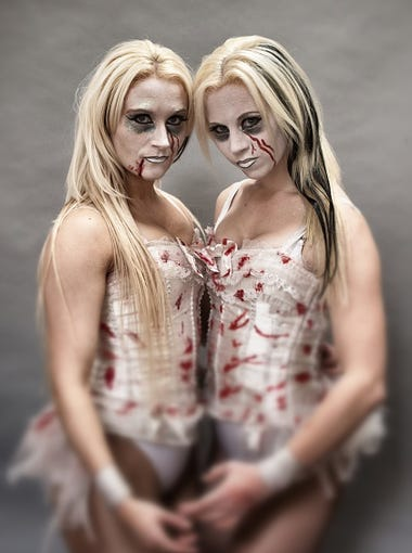 WOOKEY HOLE, ENGLAND - OCTOBER 23:  (EDITORS NOTE: This image was processed using digital filters) The Sinister Sisters, Steph Bates (L) and Steph Randall (R) pose for a photograph prior to a rehearsal of the Circus of Horrors' latest show The Night of the Zombie at the Wookey Hole Caves Theatre near Wells on October 23, 2014 in Somerset, England. The Britain's Got Talent finalists who are now celebrating their 20th year are currently touring the UK with their show - which features sword swallowers, knife throwers, balancing acts, aerialists, a demon dwarf, the Sinister Sisters and gyrating and fire limboing acrobats - at a number of venues and dates including Halloween itself in Blackpool.  (Photo by Matt Cardy/Getty Images)