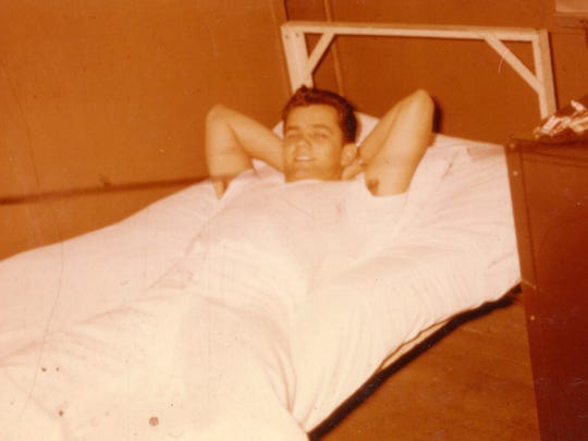 Charlie Cardwell resting in a Navy hospital bunk corpsman quarters in 1955
