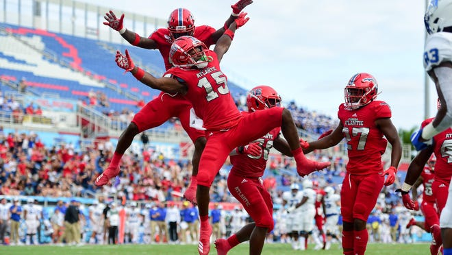 Florida Atlantic cornerback Meiko Dotson (15) celebrates his interception in a 28-13 victory at FAU Stadium on Oct. 12, 2019.