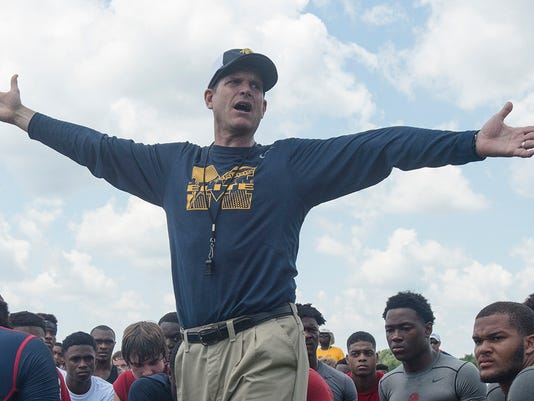 635697159265252188-AP-Michigan-Harbaugh-Camp-Fo