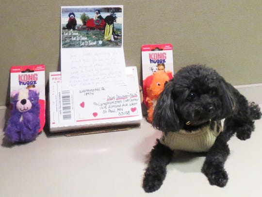 Nala poses with some of the fan mail she receives at