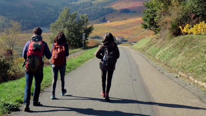 Hiking through Beaujolais are Isaac Schamberg (from left), Lys Alcayna and Bénédicte Alcayna.