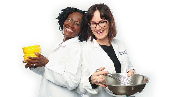 Doctors Julietta Fiscella (left) and Jennifer Carroll go into the community to share their food and their insights.