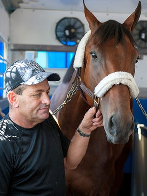 Bob Baffert assistant Jimmy Barnes and American Pharoah left from Baltimore for Louisville on Monday.