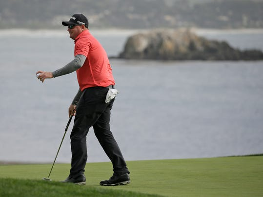 Ted Potter Jr. reacts on the 18th green of the Pebble Beach Golf Links after winning the AT&T Pebble Beach National Pro-Am golf tournament Sunday, Feb. 11, 2018, in Pebble Beach, Calif. (AP Photo/Eric Risberg)