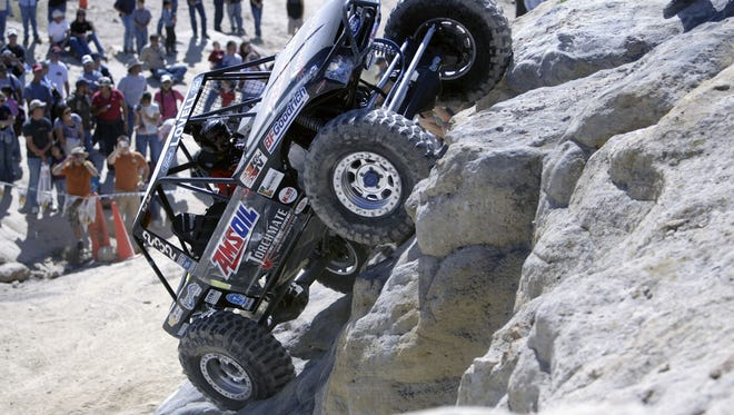 A driver competes Oct. 3, 2009, in the World Extreme Rock Grand National Championship in the Glade Run Recreation Area in Farmington.