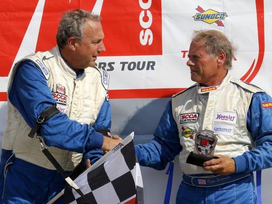 SCCA U.S. Majors Formula Vee winner Jonathan Weisheit (left) congatulates third-place finisher Roger Siebenaler in victory lane at Watkins Glen International on Saturday.