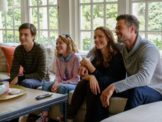 "Simon (Nick Robinson, left) enjoys family time with sister Nora (Talitha Bateman), mom, Emily (Jennifer Garner), and dad, Jack (Josh Duhamel), in ""Love, Simon."""
