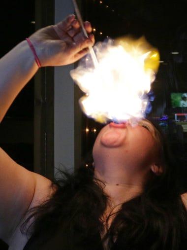 Valerie Ringwell of Sheboygan swallows a fire baton