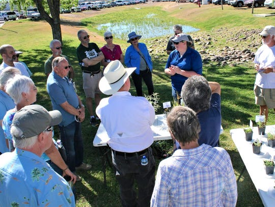 Local gardeners listen intently as Leslie Beck, NMSU
