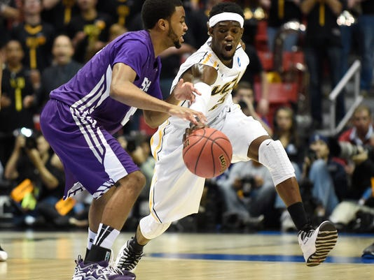 Virginia Commonwealth guard Briante Weber, right, steals the ball from Stephen F. Austin guard Dallas Cameron during the first half of a second-round game in the NCAA college basketball tournament Friday, March 21, 2014, in San Diego. (AP Photo/Denis Poroy)