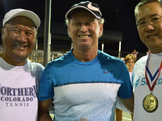 Jeff Wilson, center, presets medals to charity pro-am